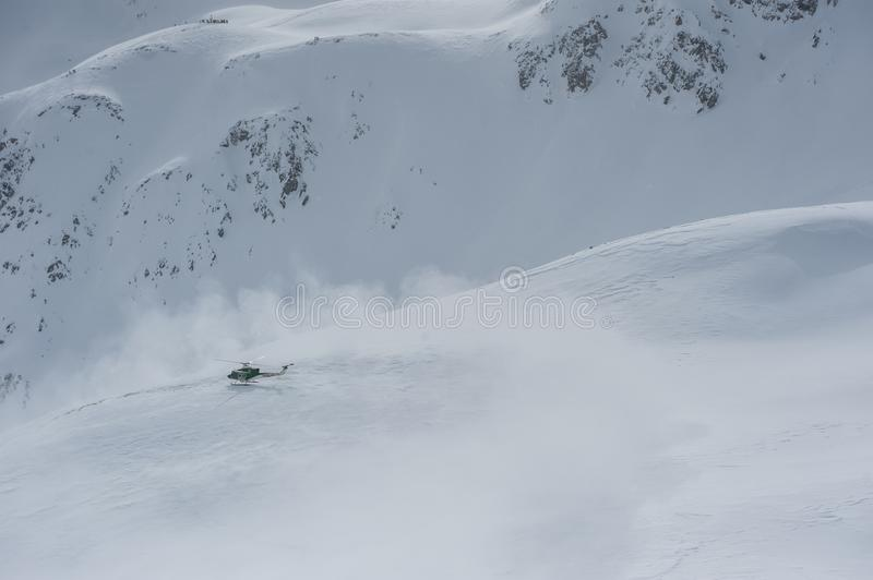 Livigno Italy, snow covered mountains with Helicopter. Livigno is a ski resort in the Italian Alps, near the Swiss border. It`s known for its snow parks, with stock photos