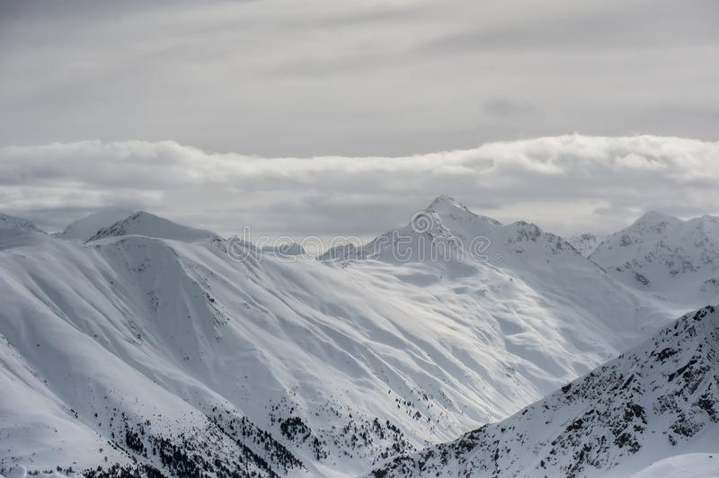 Livigno Italy, snow covered mountains. Livigno is a ski resort in the Italian Alps, near the Swiss border. It`s known for its snow parks, with slopes and trails stock images