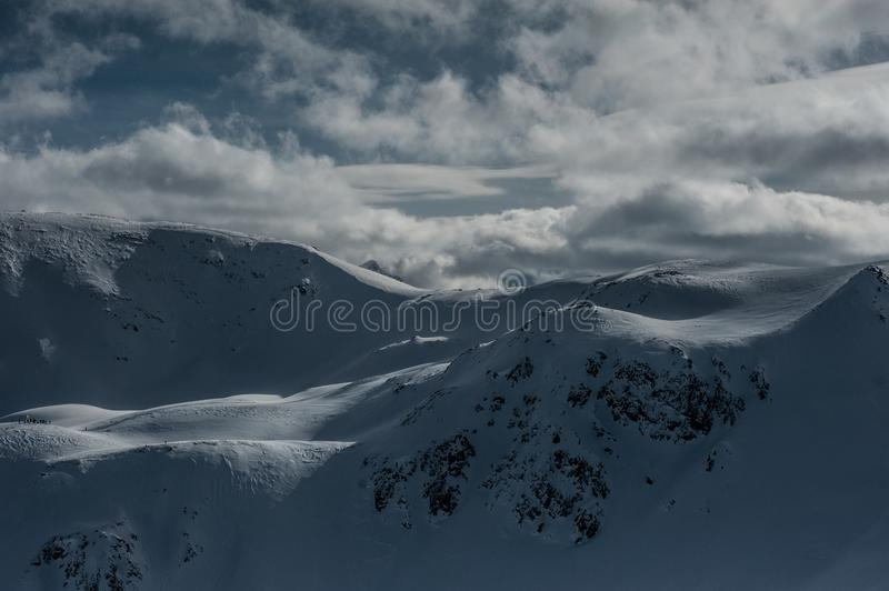 Livigno Italy, snow covered mountains. Livigno is a ski resort in the Italian Alps, near the Swiss border. It`s known for its snow parks, with slopes and trails royalty free stock photography