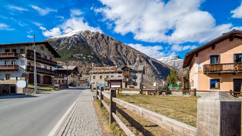 Livigno village, street view with old wooden houses, Italy, Alps. Livigno village, Italian Alpine ski and resort centre, street view with old wooden residential royalty free stock photo