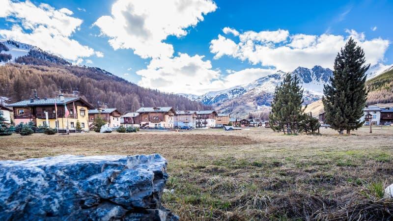 Livigno village, street view with old wooden houses, Italy, Alps. Livigno village, Italian Alpine ski and resort centre, street view with old wooden residential stock photos