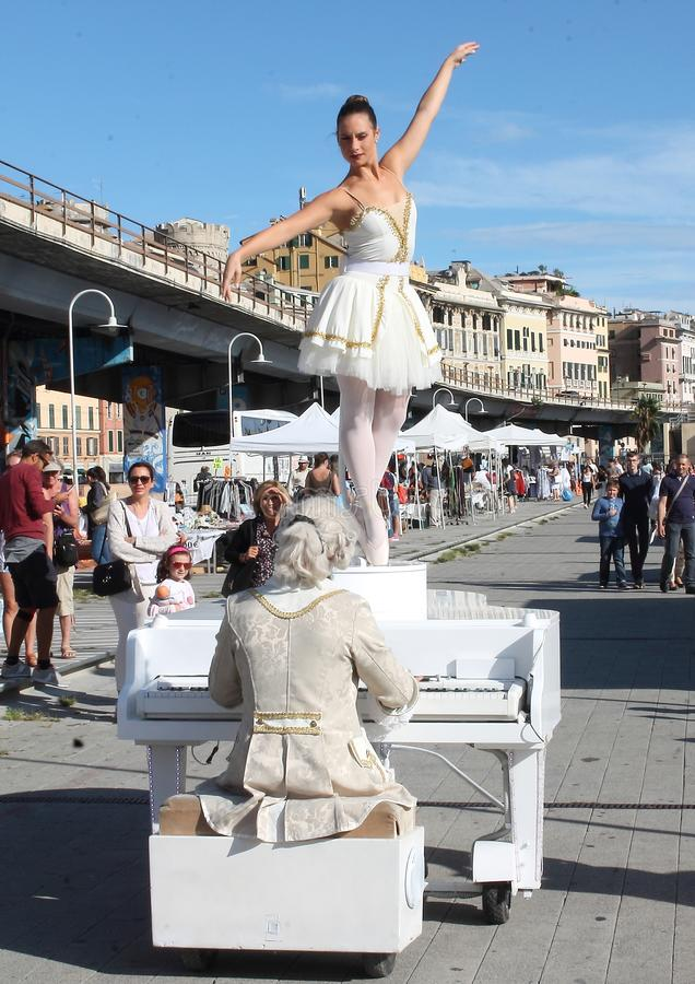 Living carillon dancer and her pianist. During the traveling show `Piano non Stop` which took place in Genoa ` Darsena ` on 1 September 2018 royalty free stock photography