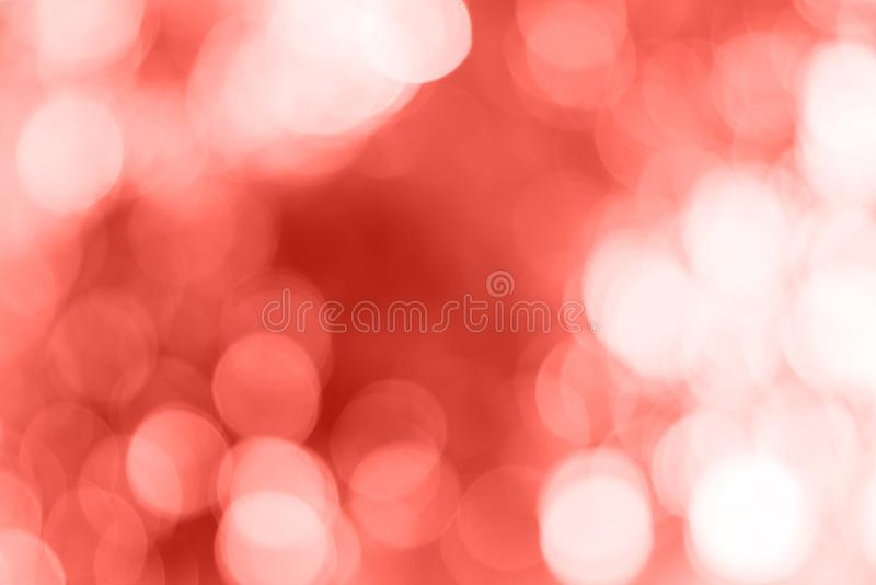 Living Coral bokeh, blurred. Color of the 2019 year royalty free stock photos