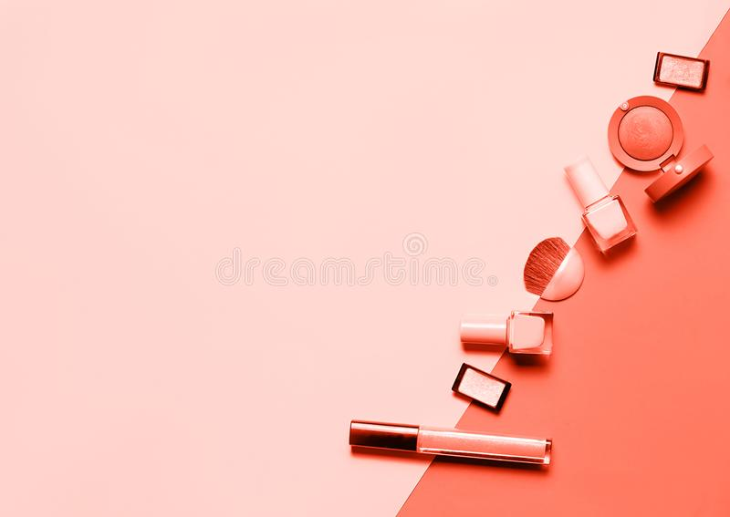 Living coral color of the year 2019 collage design: fashion beauty cosmetics set stock image