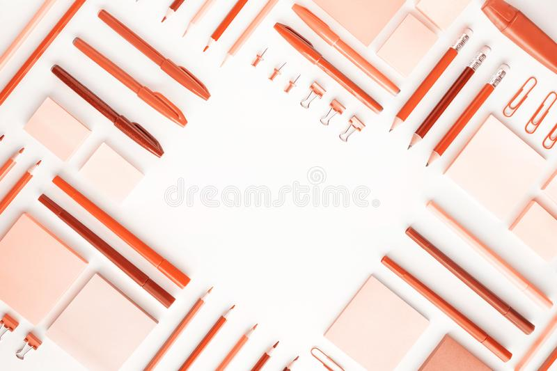 Living Coral color of year 2019 with flat lay of stationery.back to School.Modern mock up of business and education.Ideas royalty free stock images