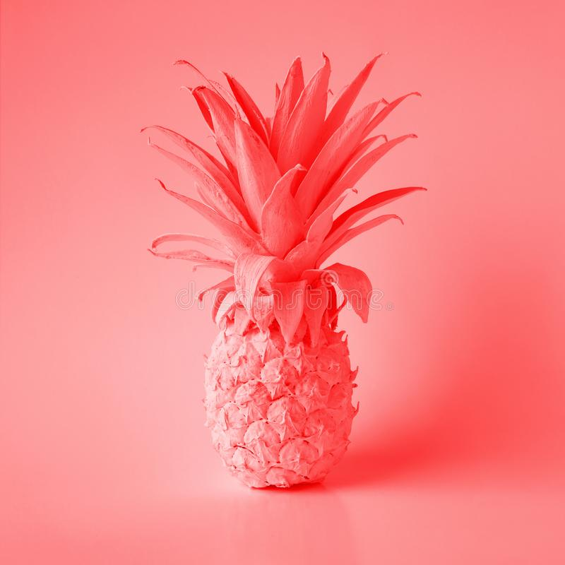 Living Coral color of year 2019 with pineapple.summer and holiday concepts stock photos