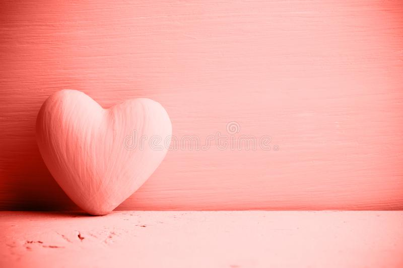 Living coral heart on the wooden background. Provencal style stock images