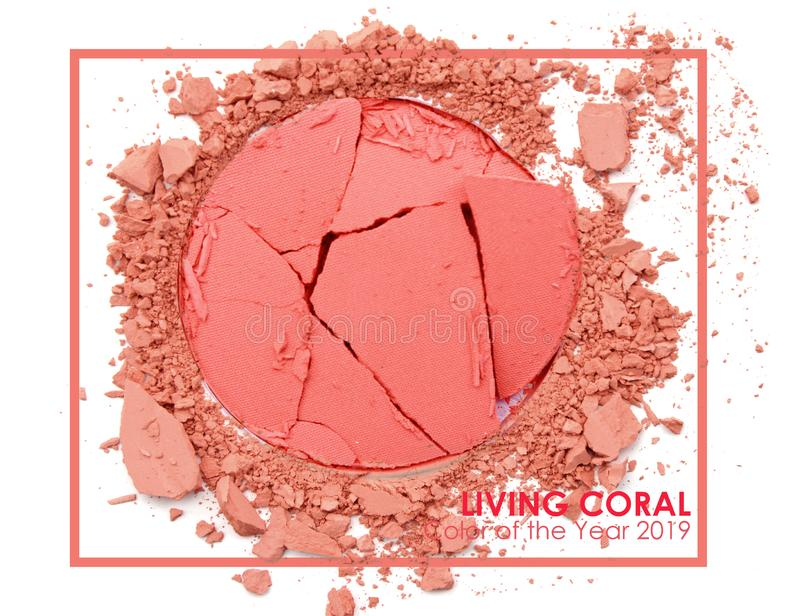 Living coral - Pan tone 2019. Make up cosmetic powder brush royalty free stock photo