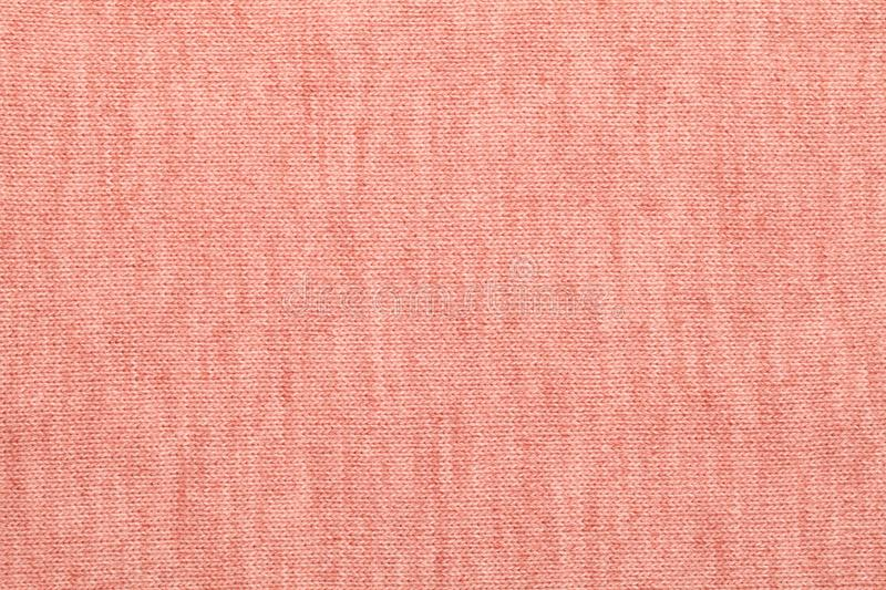 Living coral 2019 trendy color knitted melange textile pattern stock photography