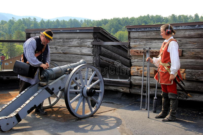 Living History Tour, with guides firing a canon,Fort William Henry,Lake George,New York,2015. Living History Tour, with a demonstration of canon firing that royalty free stock photo