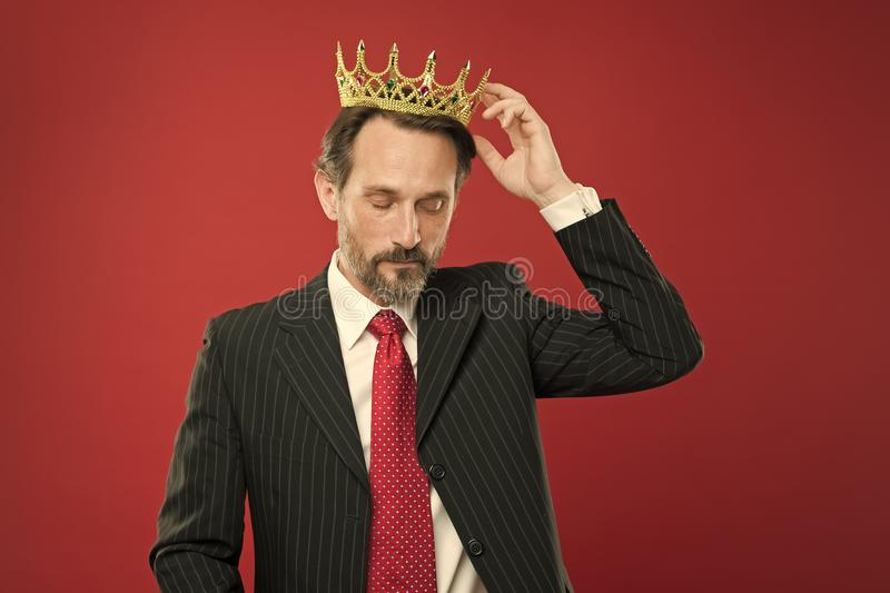 Living life like big boss. Big boss wearing jewelry crown on red background. Powerful big boss with crowned head in stock images