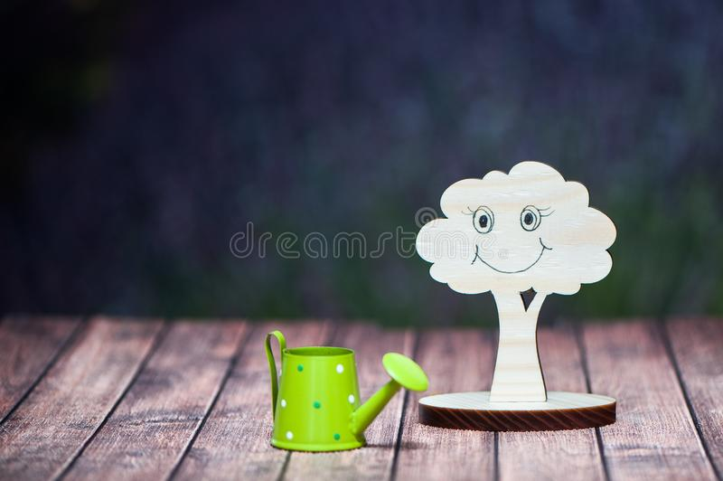 Living nature concept. Protect the environment. Symbol of a tree. And watering can on a natural background of a lavender field royalty free stock photo