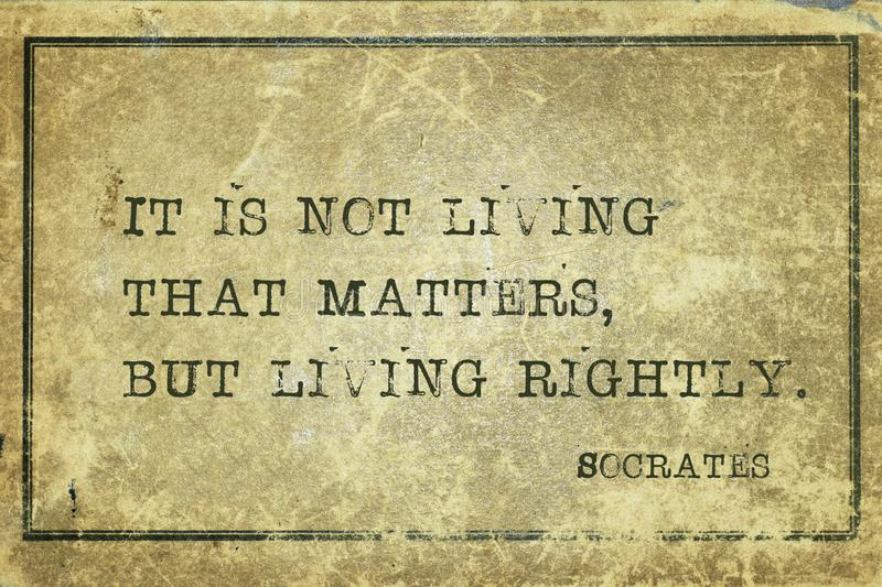 Living rightly Socrates. It is not living that matters, but living rightly - ancient Greek philosopher Socrates quote printed on grunge vintage cardboard royalty free stock photos
