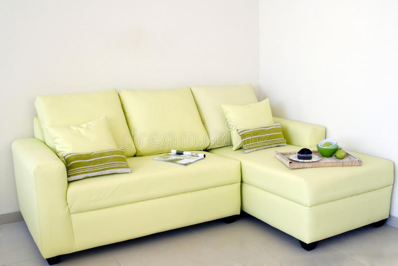 Living room. Modern comfort green living room with magazine and food royalty free stock photos
