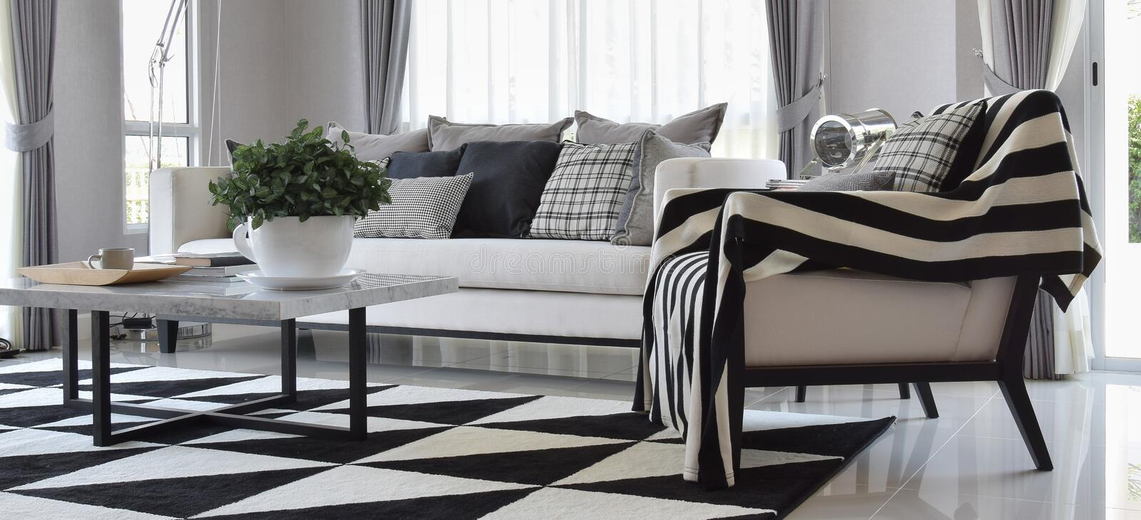 Living room with black and white checked pattern pillows stock photo