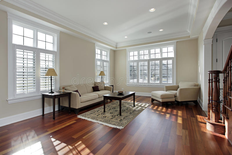 Living room with cherry wood flooring stock images