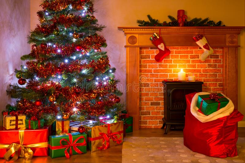 A Living room on Christmas Eve with tree and gifts royalty free stock images