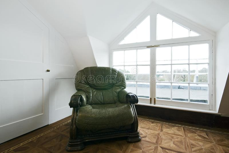 Living room detail with green vintage armchair stock photo