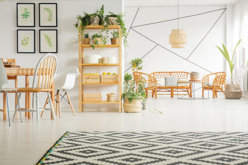 Living room and dining room. Spacious living room and dining room in modern apartment royalty free stock images