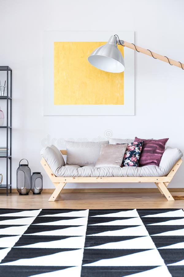 Living room with geometric carpet stock photography
