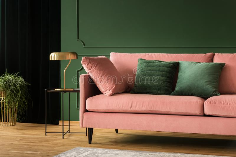 Living room glamour design, pink and green interior royalty free stock images