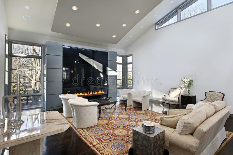 Living room with glass fireplace stock photos