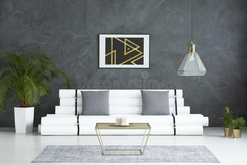 Living room with gold table royalty free stock images