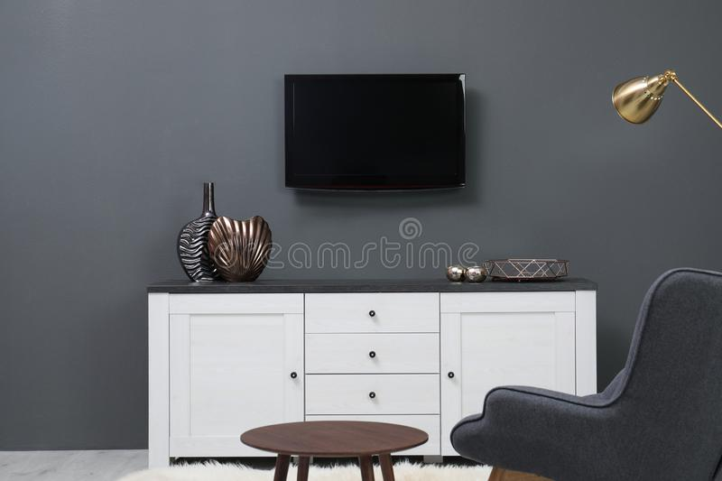 Living room interior with plasma TV on color wall. Space for design stock photo