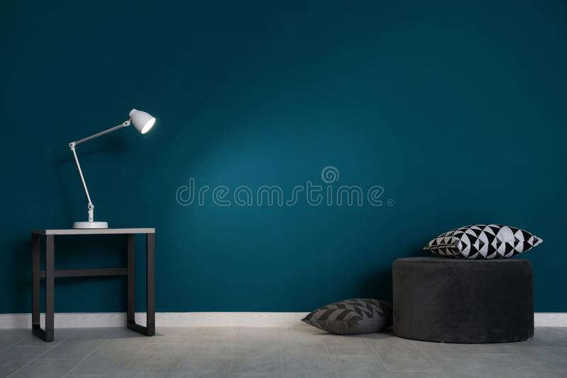Living room interior with pouf and elegant table. Near wall stock images