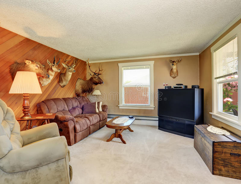 Living room interior with trophies of the hunter. stock image
