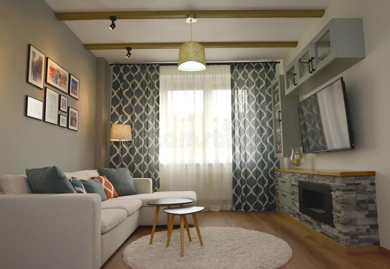 Living room interior with a wall fireplace. Scandinavian style stock photos