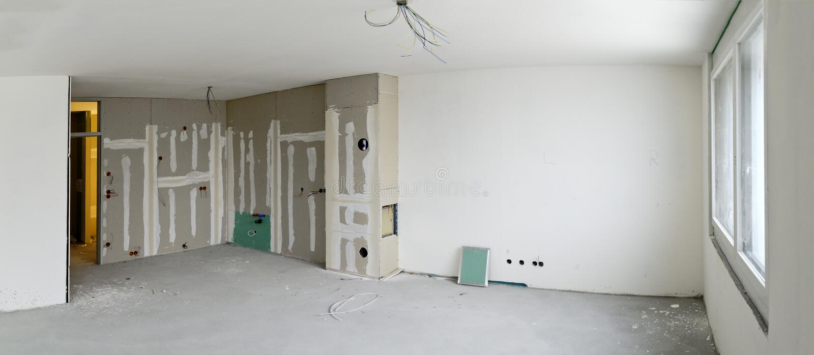Living room with kitchen corner under construction royalty free stock photography