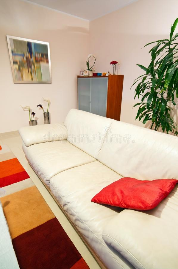Living room with leather sofa stock photography