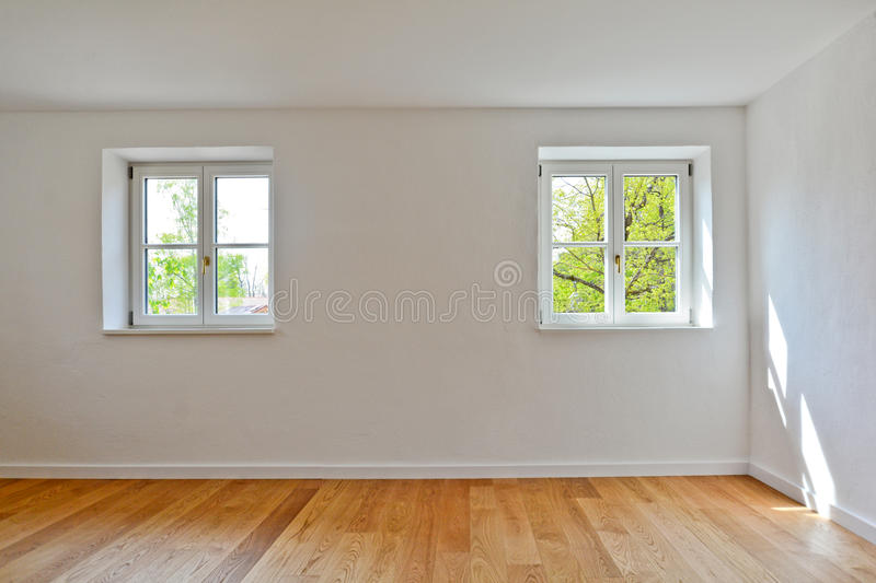 Living room in an old building - Apartment with wooden windows and parquet flooring after renovation. Living room in an old building - Empty Apartment with stock photos