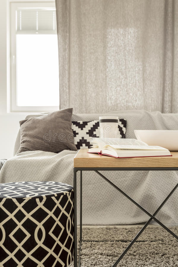 Living room with pattern pouf. Sofa and table stock photo