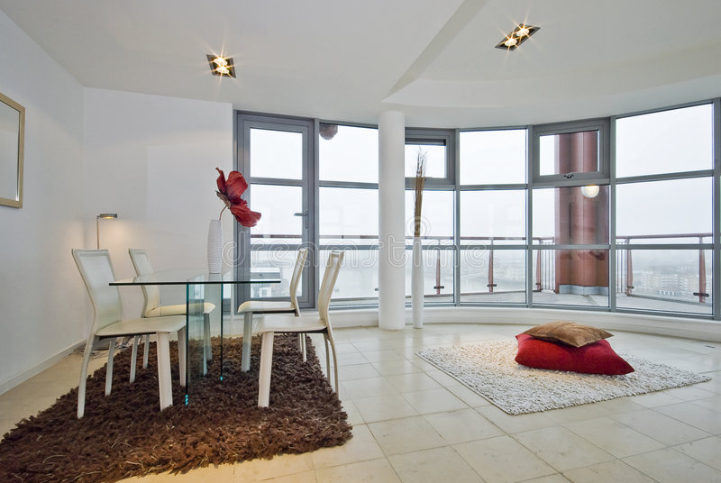 Living room of a penthouse apartment royalty free stock photography
