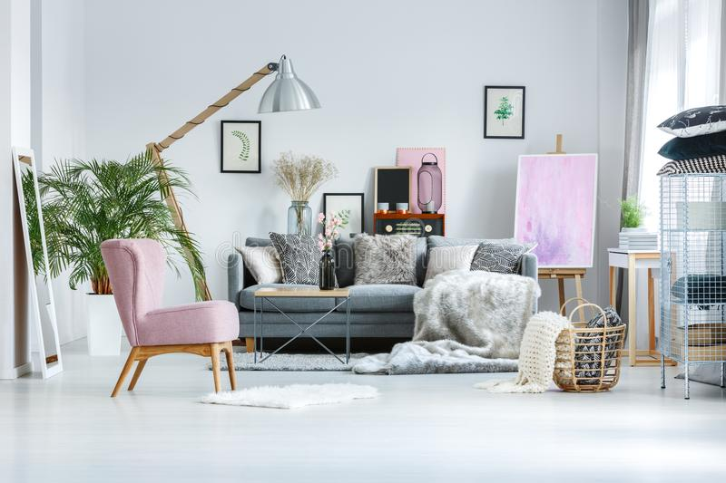 Living room with pink accents. Cozy living room with pink accents, fur blanket and decorative pillows royalty free stock photography