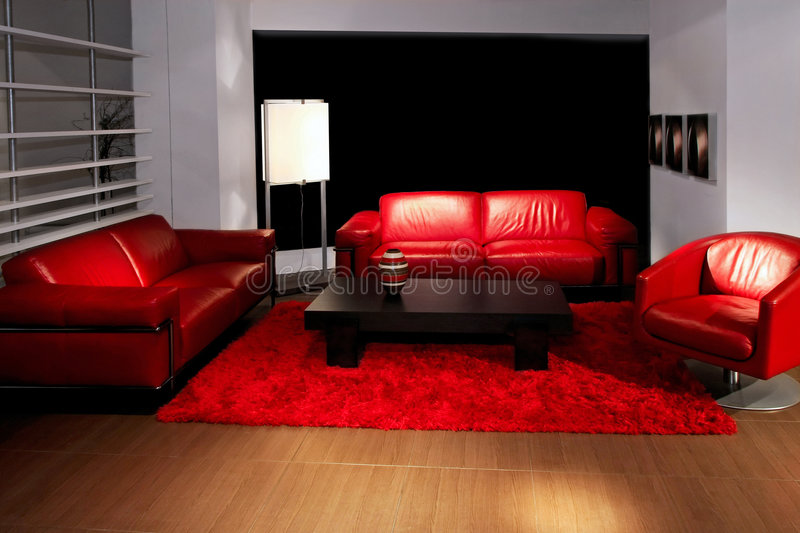 Living room red. Red living room with two leather sofas royalty free stock photography
