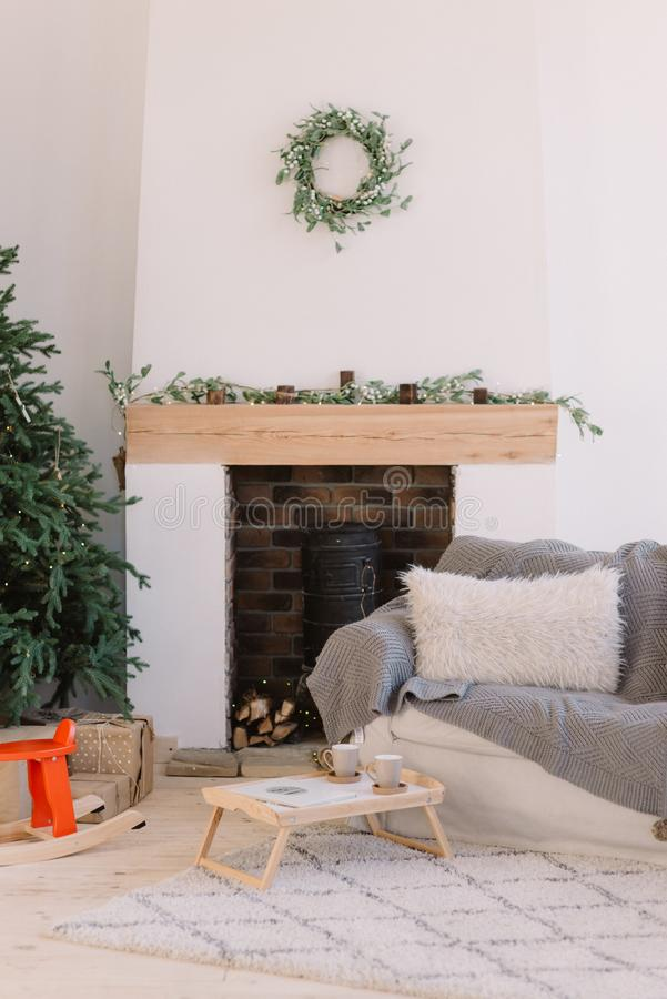 Living room in Scandinavian style with Christmas decor. Holiday background. New Year decorations royalty free stock images