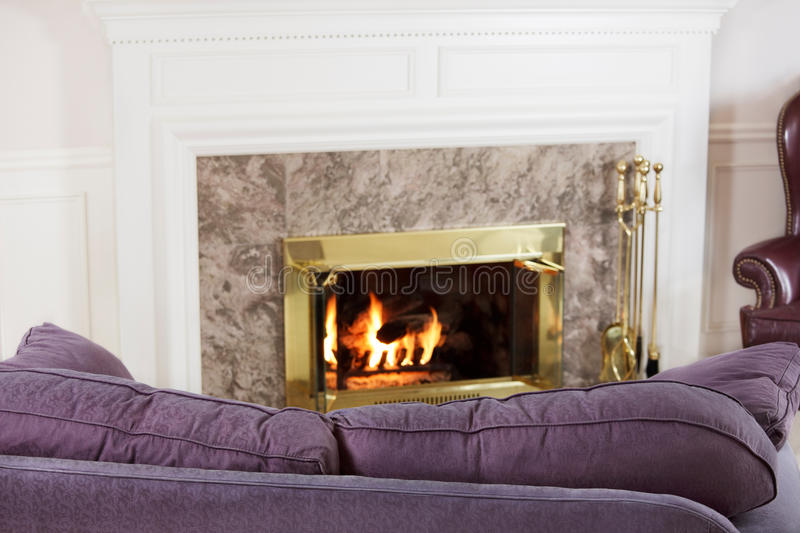 Living room sofa and fire royalty free stock image
