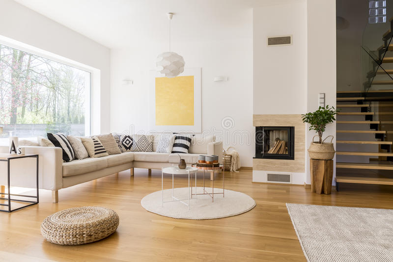 Living room with stairs. Stylish white living room with wooden stairs to the first floor royalty free stock photos