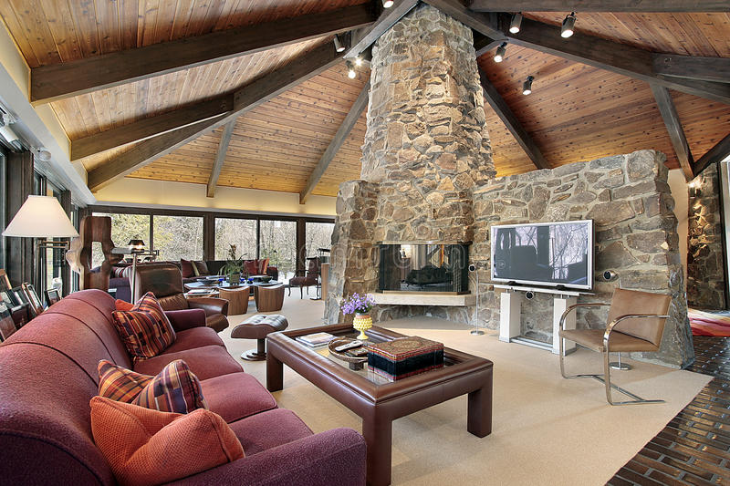 Living room with stone fireplace. Living room in country home with stone fireplace stock photography