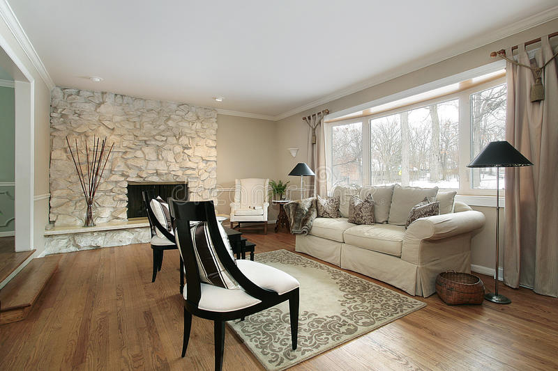Living room with stone fireplace. Living room in luxury home with stone fireplace stock image