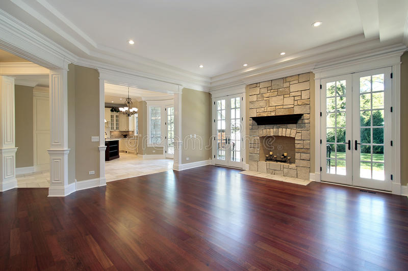 Living room with stone fireplace. Living room in new construction home with stone fireplace royalty free stock images