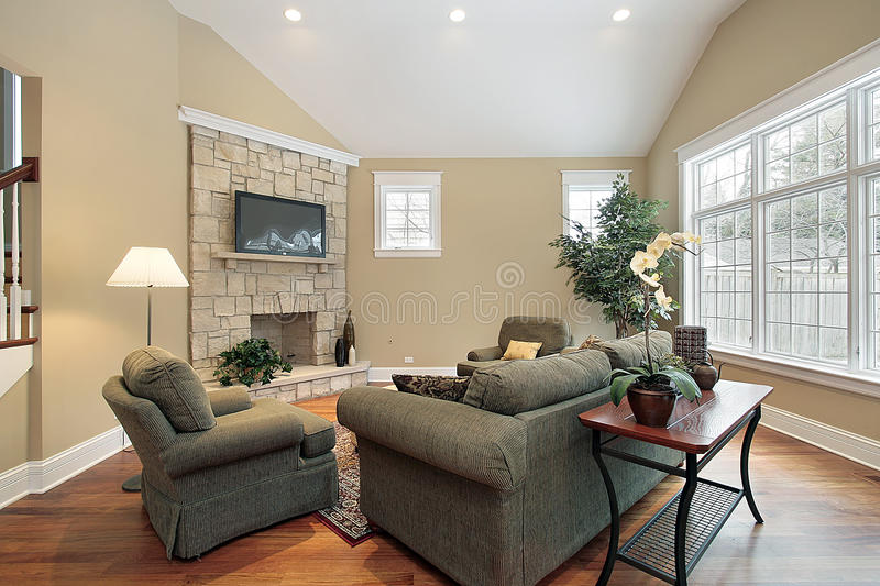 Living room with stone fireplace. Living room in new construction home with stone fireplace stock images
