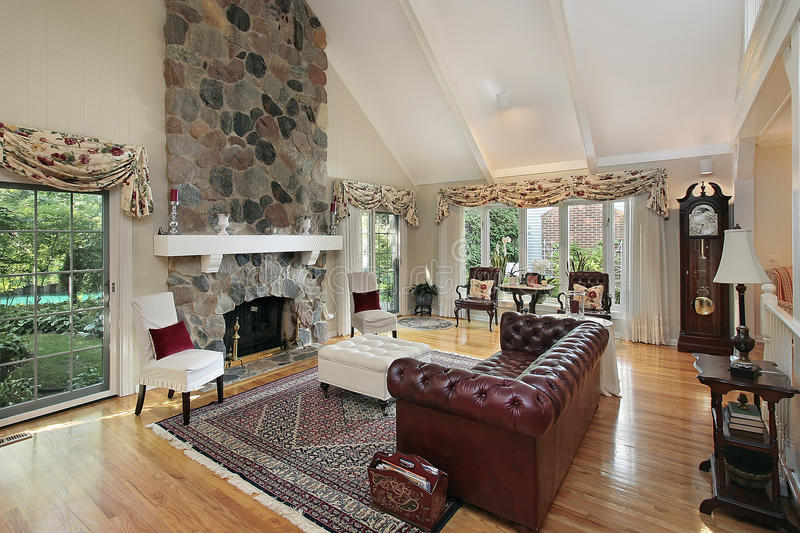 Living room with stone fireplace. Living room in home with stone fireplace stock photo
