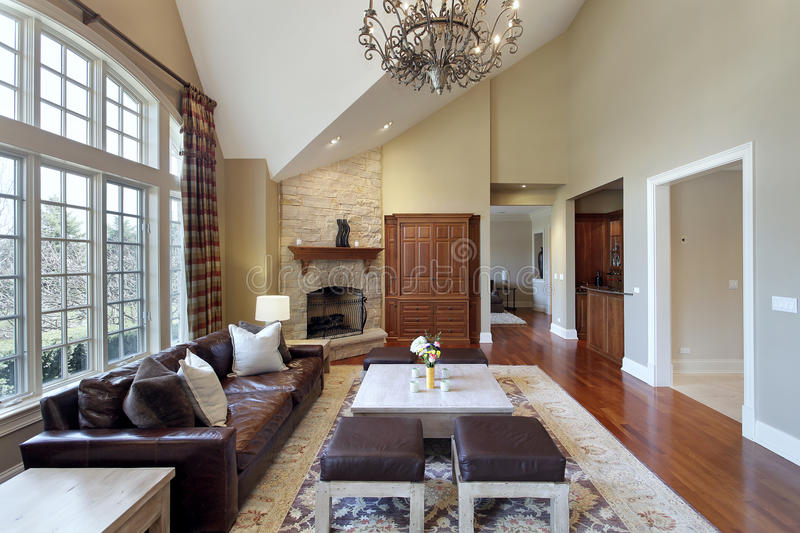 Living room with stone fireplace. Living room in luxury home with stone fireplace stock photo