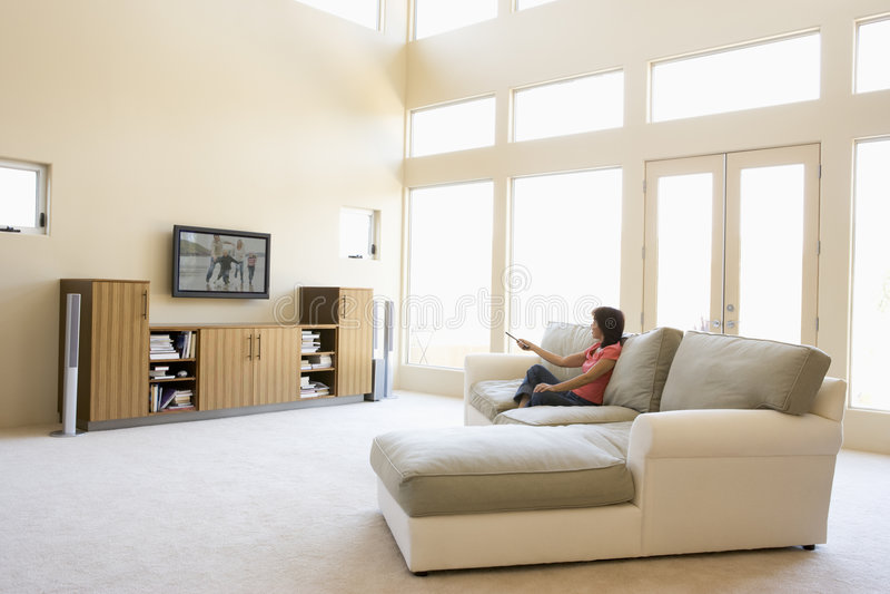 living room television watching woman στοκ φωτογραφίες