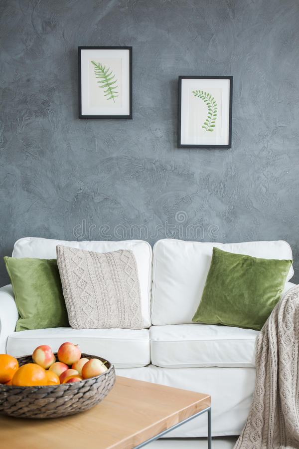 Living room with white couch. And kale green pillows royalty free stock photos