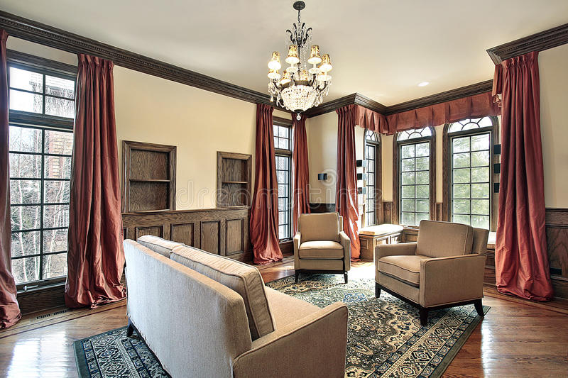 Living room with wood trim. Living room in luxury home with wood trim royalty free stock photography